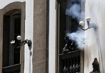 Brazil police shoot rubber bullets at protesters from historic church