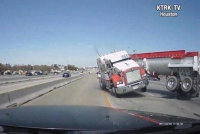 Semi jackknifes across four lanes of Houston highway, narrowly missing cars