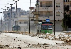 Syrian rebels leave Homs district under deal
