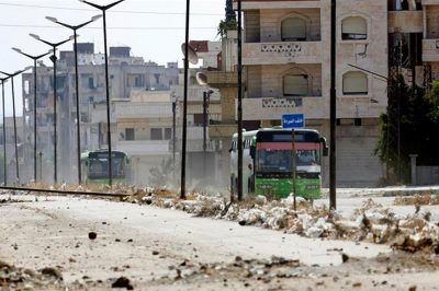 Syrian rebels leave Homs district under deal