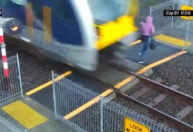 Oblivious pedestrian nearly struck by New Zealand train