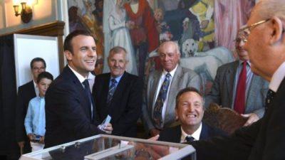 Macron's party set for parliamentary majority, polls show
