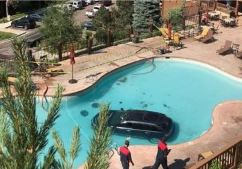 Car plunges into Colorado Springs swimming pool