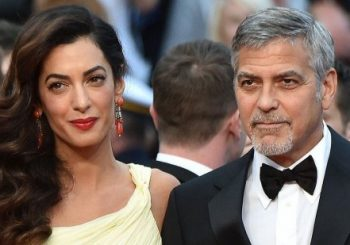 George Clooney 'to sue' French magazine for twins' photos